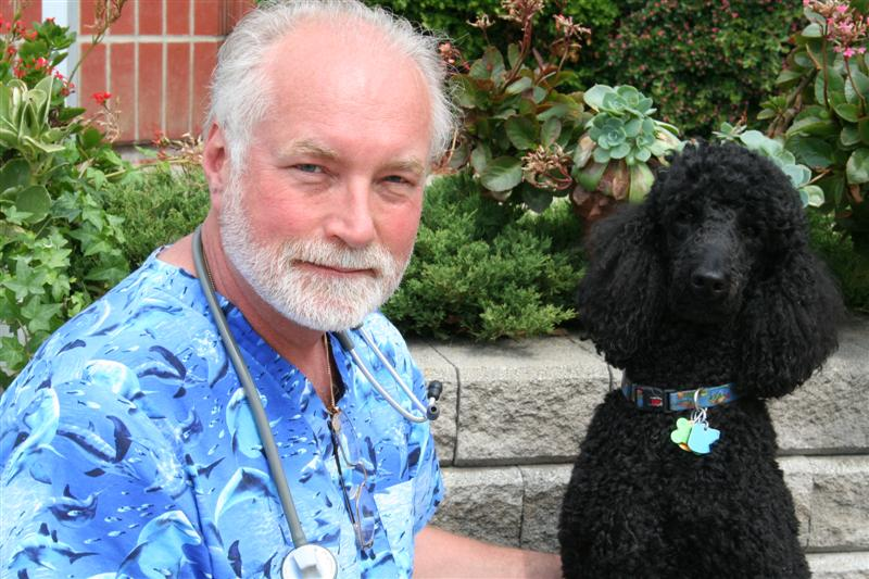 Team member Dr. Jim Sweetman with his black poodle