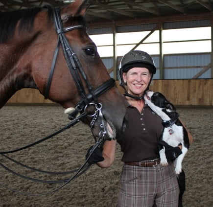 Team member Pam with her dog and horse